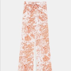 Zara orange floral print belted trousers